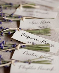 tied together lavender bunches from a local farm with calligraphed name tags for a colorful and aromatic escort card display