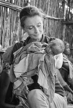 "UNICEF Goodwill Ambassador Audrey Hepburn holds a severely malnourished child at a UNICEF-assisted feeding centre in Baidoa. ""For many it's too late, but for many, many more we can still be on time,"" said Ms. Hepburn, after witnessing the impact of famine on Somalia's children in 1992."