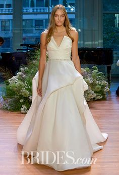 "Brides.com: . ""Emerson,"" ivory silk gazar origami strapless ballgown with hand tufted skirt and jeweled belt by Monique Lhuillier"