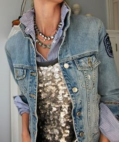 sequins tank layered over a pinstripe button down, paired with a jean jacket. layered necklaces.