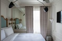 small spaces don't have to lack in creature comforts or elegance, this tiny hotel room is big on luxe... New York Hotelier, Sean Macpherson took a Greenwich Village flophouse turned it into a Left Bank inspired charmer...