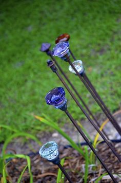 Gartenstecker of iron rods and blue glass doorknobs