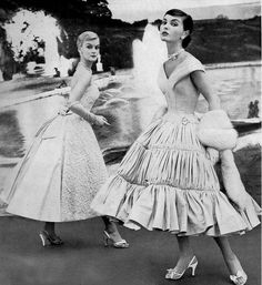 1954 Models in full-skirted party dresses by Sylvan Rich