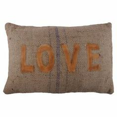 "Bring an air of romance to your living room or master suite with this leather and jute pillow, showcasing a typographic motif and center stripe.   Product: PillowConstruction Material: Cotton coverColor: BrownFeatures: Insert includedDimensions: 16"" x 24"" Cleaning and Care: Spot clean"