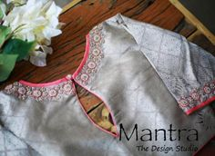 Stunning silver color designer blouse with floral design hand embroidery thread and stone work. Blouse with key hole design. 26 May 2019 Source by acheivermahesh Blouses Designer Blouse Patterns, Fancy Blouse Designs, Blouse Neck Designs, Latest Blouse Designs, Simple Blouse Pattern, Mirror Work Blouse Design, Stylish Blouse Design, Embroidery Thread, Embroidery Neck Designs