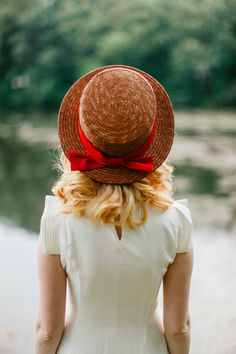 Straw hat with a red bow