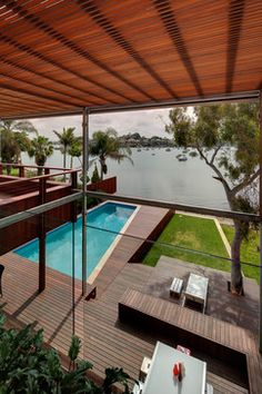 Tennyson Point - contemporary - pool - sydney - CplusC Architectural Workshop  built up deck on part of pool... for covering cover?