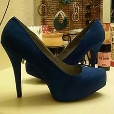 Torrid cobalt blue NWOT.. Gorgeous blue color... Sort of a mix between navy & royal blue... Second pic taken with flash so you can see the blue color... 5in heel/1in hidden platform... Never worn Torrid Shoes Heels
