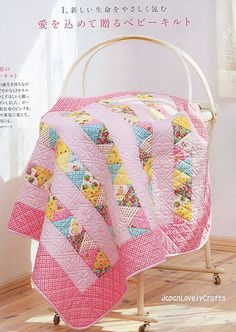 HAPPY QUILT BY ATSUKO MATSUYAMA                   What a cute baby quilt.  Love the colors.  Would probably do bricks instead of triangles