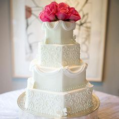 Geometric Wedding Cake: Hexagonal wedding cake tiers offer a sleek, modern alternative to round or square tiers. Contrast the geometric shapes with soft frosting swirls and fondant swags. Use flowers for an always-gorgeous wedding cake topper.