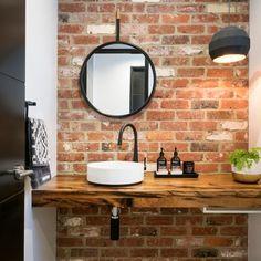 This powder room @ladylovesliberty very stylish. #blacktap #timbertop #redbrick #powderroom