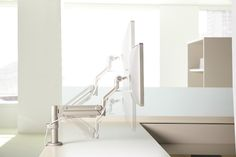 MAST is the first monitor support arm on the market designed specifically to support today's workplace requirements while anticipating the next level of technology, including tablets, oLED and curved screens. Lighting Solutions, Screens, Product Design, Workplace, Monitor, Flow, Sink, Arms, Technology