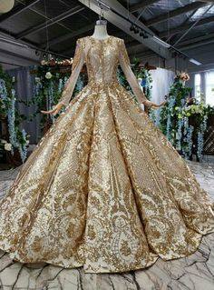 Silhouette:ball gown Hemline:floor length Neckline:scoop Fabric:sequins Shown Color:gold Sleeve Style:long sleeve Back Style:lace up Embellishment:sequins beading