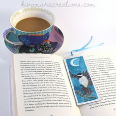 Bookmarks printed from my original artwork are now available! $5 each and laminated for years of use. I have five designs available. This one is called 'Winter Chickadee.' Check out all five styles on my website, kivamariecreations.com, or on my Etsy page.