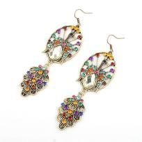 PeacockMulticolored Swarovski Crystal center Silver tone Earrings.  These Measure 3 inches long and hang from fish hook ear hoops.  Every piece is brand new and made with the highest quality materials.  Thank you for taking the time to look at my y...