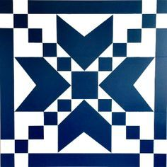 large navy and white barn quilt