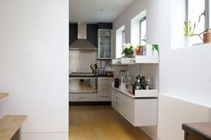 Cabinets and shelves provide the bridge between the kitchen and dining area