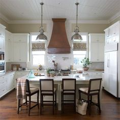 white kitchen + copper hood