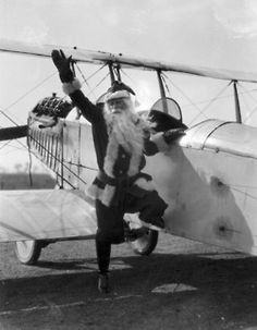 "Not even Santa Claus could resist the excitement over ""Lucky Lindy"" and air travel. Here Santa tries out a substitute for his sleigh just months after Charles Lindbergh's famous 1927 transatlantic flight.  iChi-03166. #chicago #history #christmas #holidays #santa"
