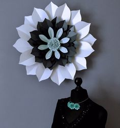 Strikingly beautiful flower, an on trend piece of paper sculpture, a beautiful piece of unique art for your home and perfect as an over mantle statement instead of a mirror.  This flower style can be incorporated into a backdrop for a special event or photography background.  The flowers are made t