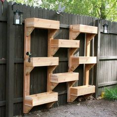 Great way to do vertical/city gardening and cover the ugly privacy fence