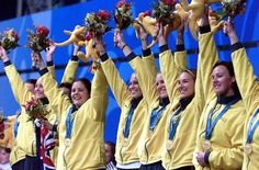 The Australian women water polo team celebrates on podium after presented with their gold medals after defeating USA in final at the Sydney Olympic Games. Picture: Gregg Porteous