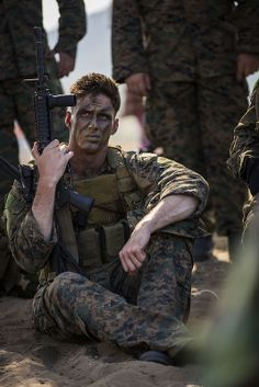 U.S. Marine Corps Cpl. Justin Federhofer, sits during a safety brief prior the start of the rehearsal for the combined amphibious landing demonstration conducted as part of Exercise Cobra Gold 2014 at Hat Yao beach, Rayong, Kingdom of Thailand, #USMC