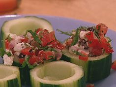 Mediterranean Cucumber cups with feta, tomato, onion, pepper, and olive.  Easy, healthy appetizers.