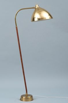 Lisa Johansson-Pape; Perforated Brass and Leather Floor Lamp for Orno, 1940s.