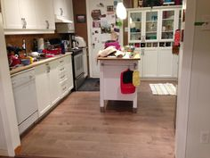 Kitchen after - the changes aren't as staggering as everywhere else, but the consistent flooring makes it feel much more open.  Now just to clean all the crap off the counters!