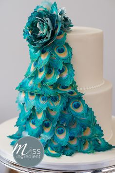 Wedding Cake with a cascade of peacock feathers, all edible by Miss Ingredient