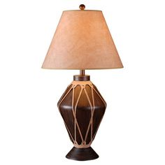 Cast a warm glow in your living room or library with this drum-inspired table lamp, featuring a faux leather shade.  Product: Ta...