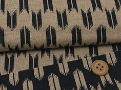 Japanese double gauze fabric, here in a dark navy arrow pattern.  Excellent for clothing in hot, humid climates.