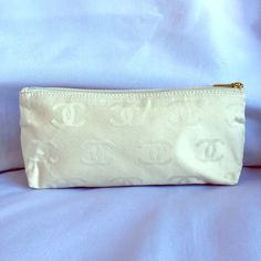 "Selling this ""Chanel Cream Logo Cosmetic Bag"" in my Poshmark closet! My username is: theachloe. #shopmycloset #poshmark #fashion #shopping #style #forsale #CHANEL #Bags"