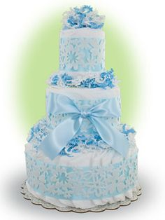 Our Blue Lace cake consists three layers of premium Pampers brand diapers bundled together with easily removable ribbon so that every diaper is useable.  Makes a darling and elegant new baby gift. Only $49.00