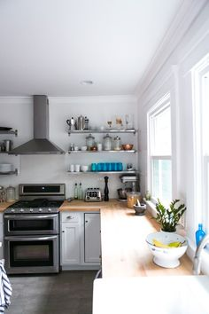 Behind the Scenes: Our Kitchen Reno by A Couple Cooks // storing essentials on an exposed shelf for easy access but also added aesthetic interest