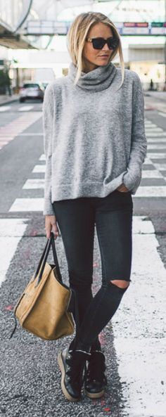 205.#fashion #outfits #black Baggy polo neck sweater + ripped black jeans + Janni Deler + sneakers + leather tote bag  Jeans: Anine Bing, Sweater/Shoes: Me & The Met, Bag: Celine.