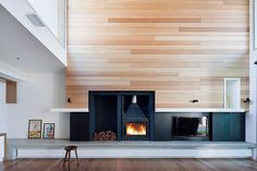 Beautiful timber feature wall - Rachcoff Vella Architects(Wooden Step Over Concrete) Freestanding Fireplace, Wood Fireplace, Fireplace Surrounds, Fireplace Console, Fireplace Gallery, Fireplace Ideas, Timber Feature Wall, Feature Walls, Contemporary Fireplace Designs