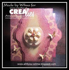 Made by Wilma: https://www.crealies.nl/detail/1260030/15-04-06-wilma.htm Crealies items: On the Ege no. 3 Set of 3 stansen no. 23 Bloemen 14/Flowers 14 Crea-Nest-Lies XXL no. 22 Crea-Nest-Lies Small no. 6 Kiekeboo Rond/Peekaboo Round Masks & More no. 19 Grote cirkels/Big circles Masks & More no. 20 Kleine cirkels/Small circles Bits & Pieces no. 3 Crackle