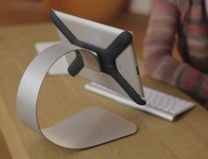 "Boomerang for the iPad has been modeled as a stylish, lightweight, slim ""shown here with the optional stainless steel iPad table stand"" providing ergonomic typing and viewing angles. Boomerang attaches to all our accessories via our amazing magnetic interface. Combined with Boomerang's mounting accessories, an iPad becomes a hands-free personal entertainment device at the gym, it's your cooking assistant in the kitchen. Boomerang is full compatible with all iPads (except iPad 1 and iPad…"