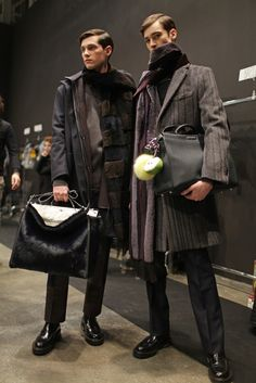 Two ways to carry a bag backstage at Fendi Men's RTW Fall 2015. [Photo by Kuba Dabrowski]