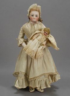 In the photos here, you will see a nursemaid in the form of an all original Louis Doleac fashion, one from the Grovian Doll Museum's Collection of fashion dolls. Here, you will note that the doll wears a costume in cotton, as opposed to silk, and a lacy cap that denotes her role.