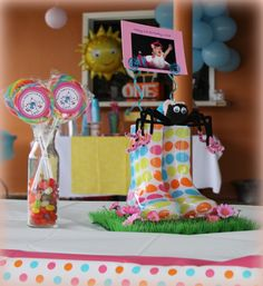 Lexi's 1st Birthday Party - inspired by The Itsy Bitsy Spider. Rain boots as centerpieces
