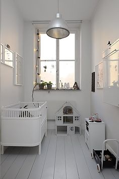 A small and narrow nursery looks great in all white
