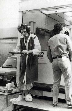 Brian May having lunch during the filming of the music video for I Want To Break Free by Queen