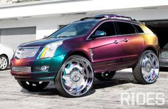 The 2010 Cadillac SRX featuring Chameleon paint job, Forgiato and suicide doors. My Dream Car, Dream Cars, Dream Life, Pimped Out Cars, Lincoln, Lyna Youtube, Detroit, Car Paint Jobs, Donk Cars
