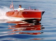 Chris Craft - one of the prettiest boats ever. I would trade my Cobalt for this Chris Craft.