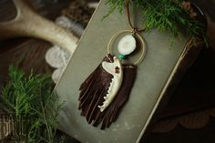 leather fringe necklace with opossum jawbone & deer antler slice sold by Sage Fox. Shop more products from Sage Fox on Storenvy, the home of independent small businesses all over the world.