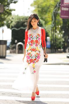 floral print dress with red blazer and shoes