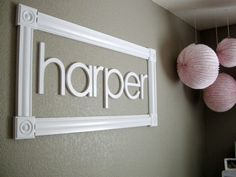 Name in a frame, I love this! Wood letters attached to the wall, add a wood frame and project done :) Super cute for a kid's room or with your family's last name in the living room.